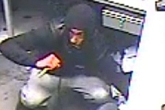 The man entered the betting shop armed with a large knife
