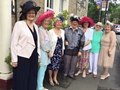 L-R: Joan McLean, Cllr Pat Lord, Sylvia Curley, John Tomlinson, Cllr Pam Byrne, Alma McInnes, Betty Tomlinson (organiser) at The Old Bell, Delph. It was an Ascot Ladies Day lunch with horse racing. Think they were raising funds for Macmillan with  any profits.