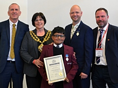 Ibrahim receiving his British Citizen Youth Award
