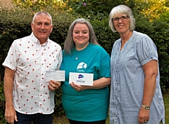 Sarah Fitchett, from Papyrus, receives a cheque from Musical Friends' Paul Osbaldiston and Jayne Collins