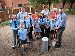 (From left): FCHO's Jamie Smith, teacher Miss Wood, Head Miss Bowers, Cllr Roberts and FCHO's Reece Cumiskey with some of the Thorp Road pupils