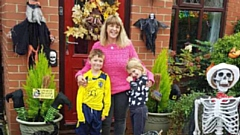 Tracy Buckley is pictured with her children, Frankie, eight, and Scarlett, six, at their house