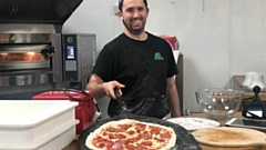 Kyle Freeman making another lovely pizza