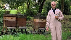 Rev Dr Halliday is pictured with a pot of the honey