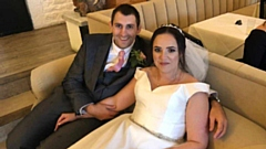 Phil Joy and Laura are pictured on their big day