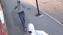 Greater Manchester Police are looking for these two men in connection with the robbery back in September.