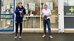 Picture show Bent (left) and Martin Molyneux, of St Chad's pharmacy, showing off the boots outside the Lime Green Parade store.