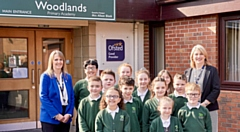 Happy staff and pupils at Woodlands Primary Academy