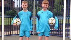 Twins Daniel (left) and Jake Smith show off the smart new St Mary's strip