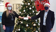 Claire Crossfield is pictured receiving a �300 cheque from Jon Stocker of Saddleworth Rotary Club