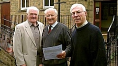 Colin Smith is pictured (left) outside the Millgate Arts Centre in Delph in 2011 during the time he was Chair of Trustees. Then stage director Ken Wright and treasurer David Shipp are also on the picture