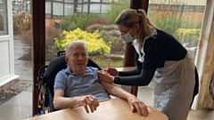 Michael McKeever receives his vaccination earlier today. Image courtesy of Oldham Cares on Twitter