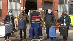 Chadderton firm Ultimate Products have made things a little bit easier with the donation of thousands of pounds worth of key household items - from suitcases to ironing boards, from pots and pans to kettles