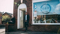 Barber and business owner Darren O'Neill (right) and Jack are pictured outside their Failsworth premises