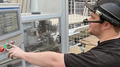 A machine operator testing out handsfree smart glasses.