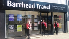 Louise Jones, Laura Hatch and Elise Jamieson are pictured outside Barrhead Travel's Oldham office