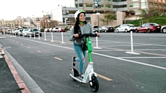 A Lime E-scooter in action