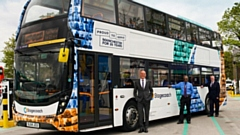Pictured is a special livery bus featuring 30 of its longest serving members of staff